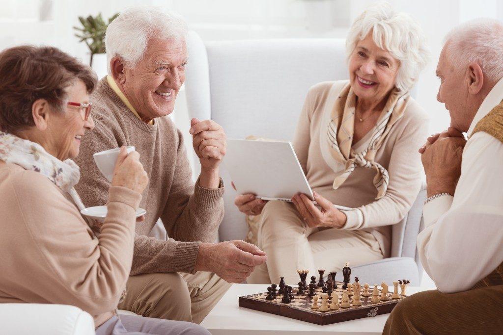 Elderly neighbors playing chess