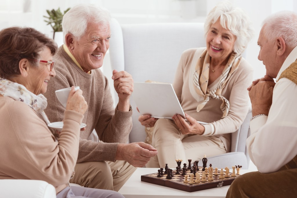 Elderly neighbors playing chess