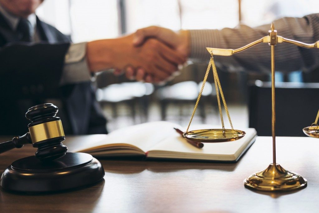 Attorney shaking hands with client