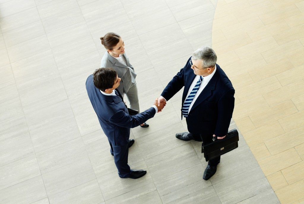 Businesspeople shaking hands after negotiation