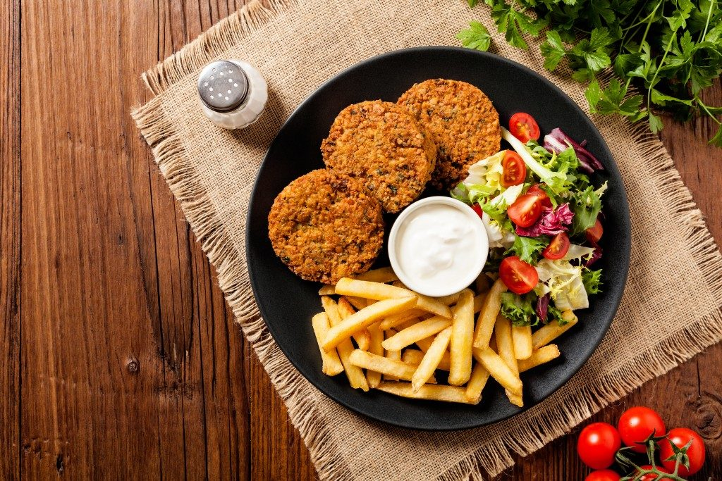 Falafel and chips served on a plate