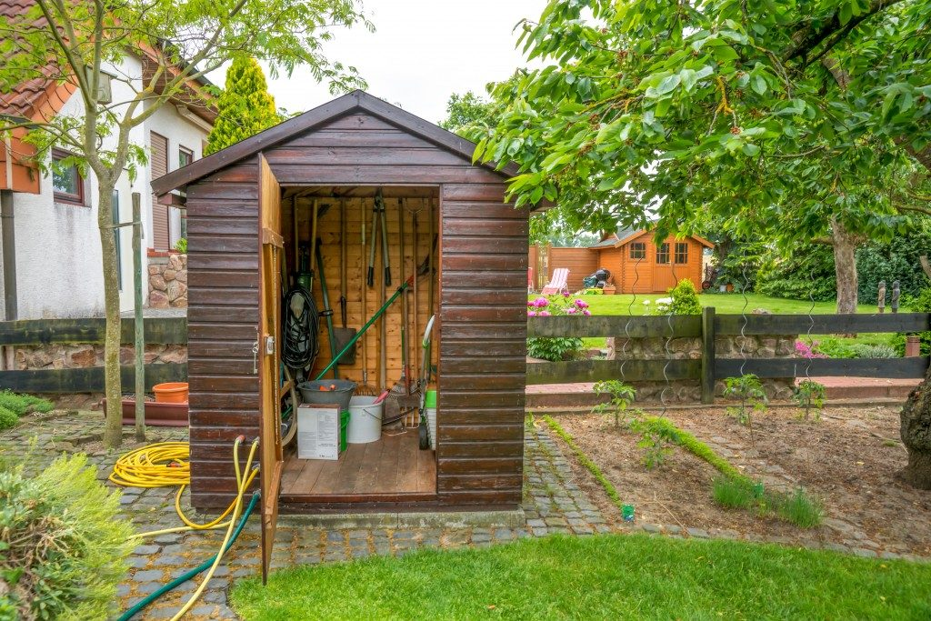 storage shed with gardening tools