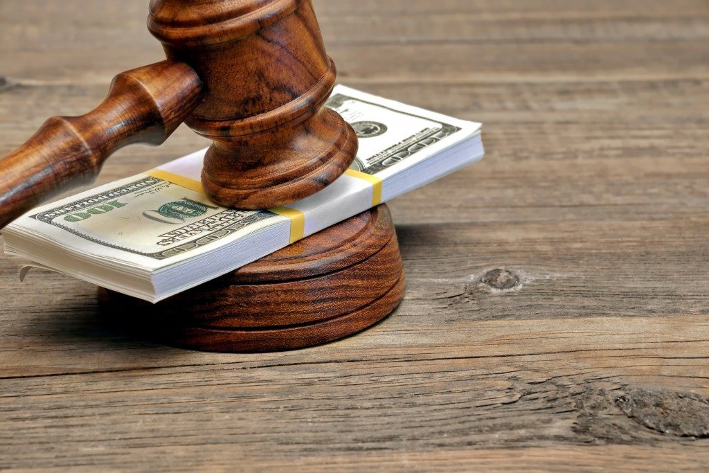 bail concept with money on gavel
