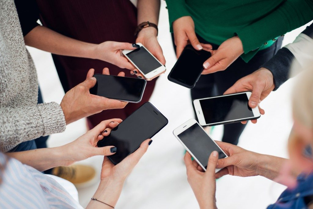 colleagues using their smartphones