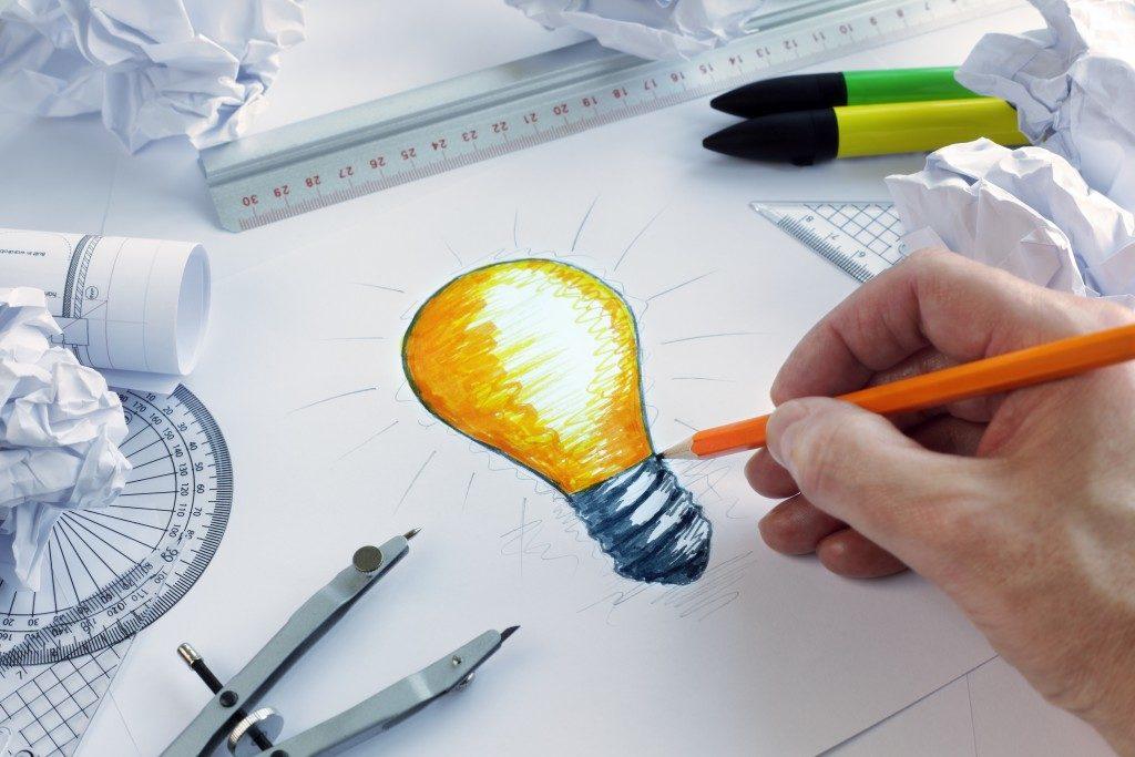person's illustration of a light bulb representing an idea