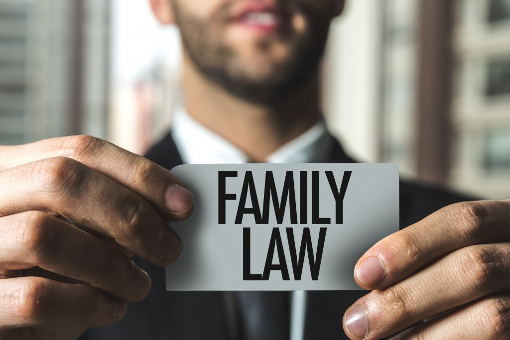 "Man holding ""family law"" sign"