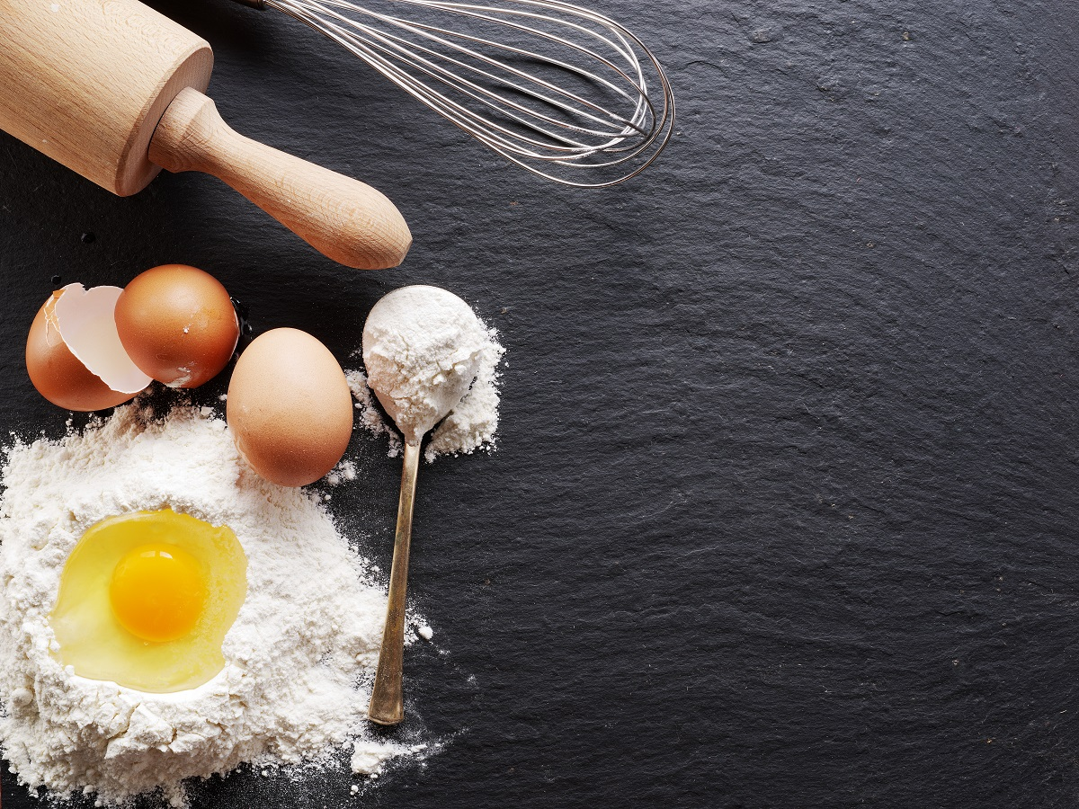 eggs flour, whisk and rolling pin