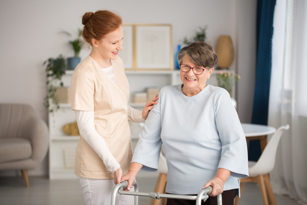 nurse helping an elderly
