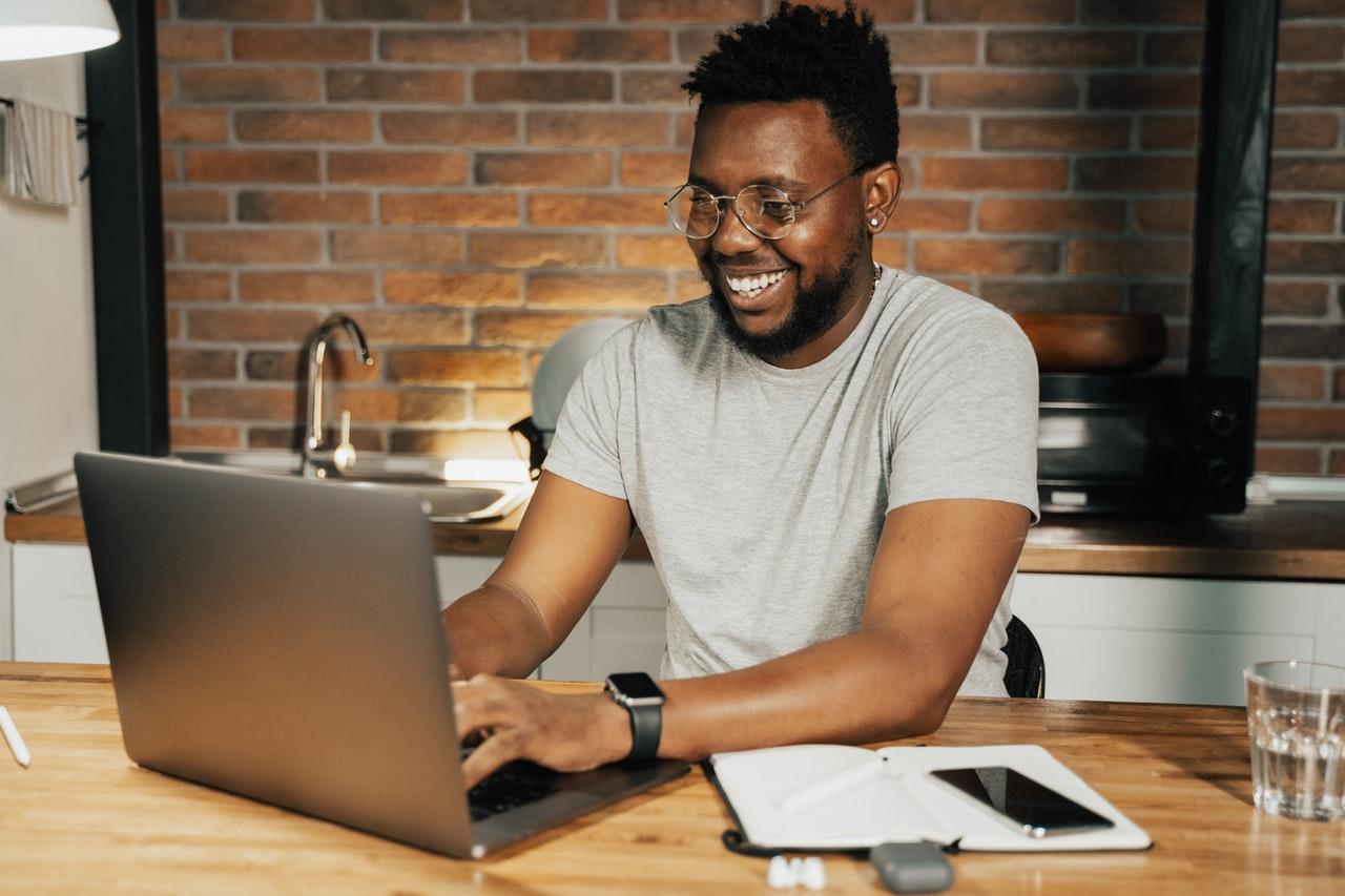 man using his computer at home