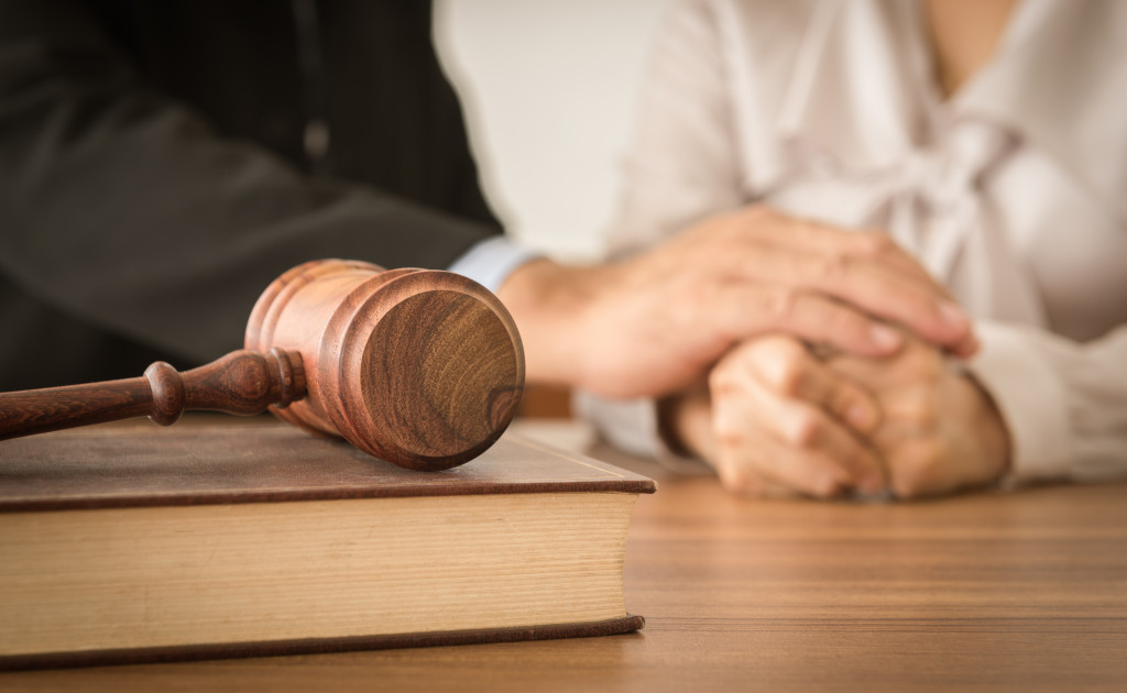 judge holding defendant hand